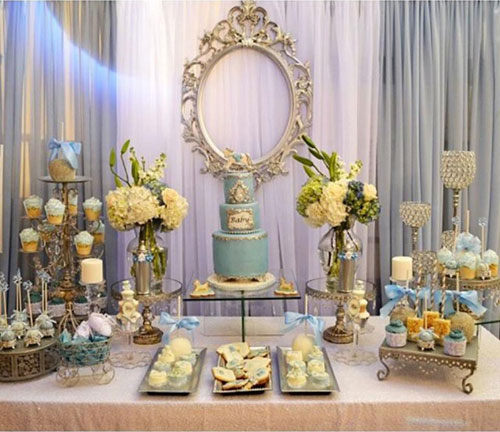 dessert table with cake and cupcakes