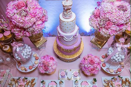 dessert table with cake and cupcake
