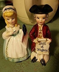 Colonial couple salt and pepper shakers