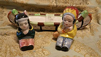 Indian couple in canoe, salt and pepper shakers
